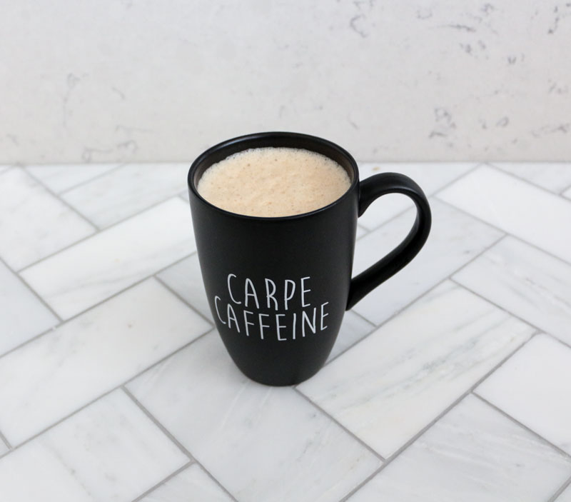 bulletproof-coffee-in-a-black-coffee-mug-carpe-caffeine-1111-light-lane-1-of-1