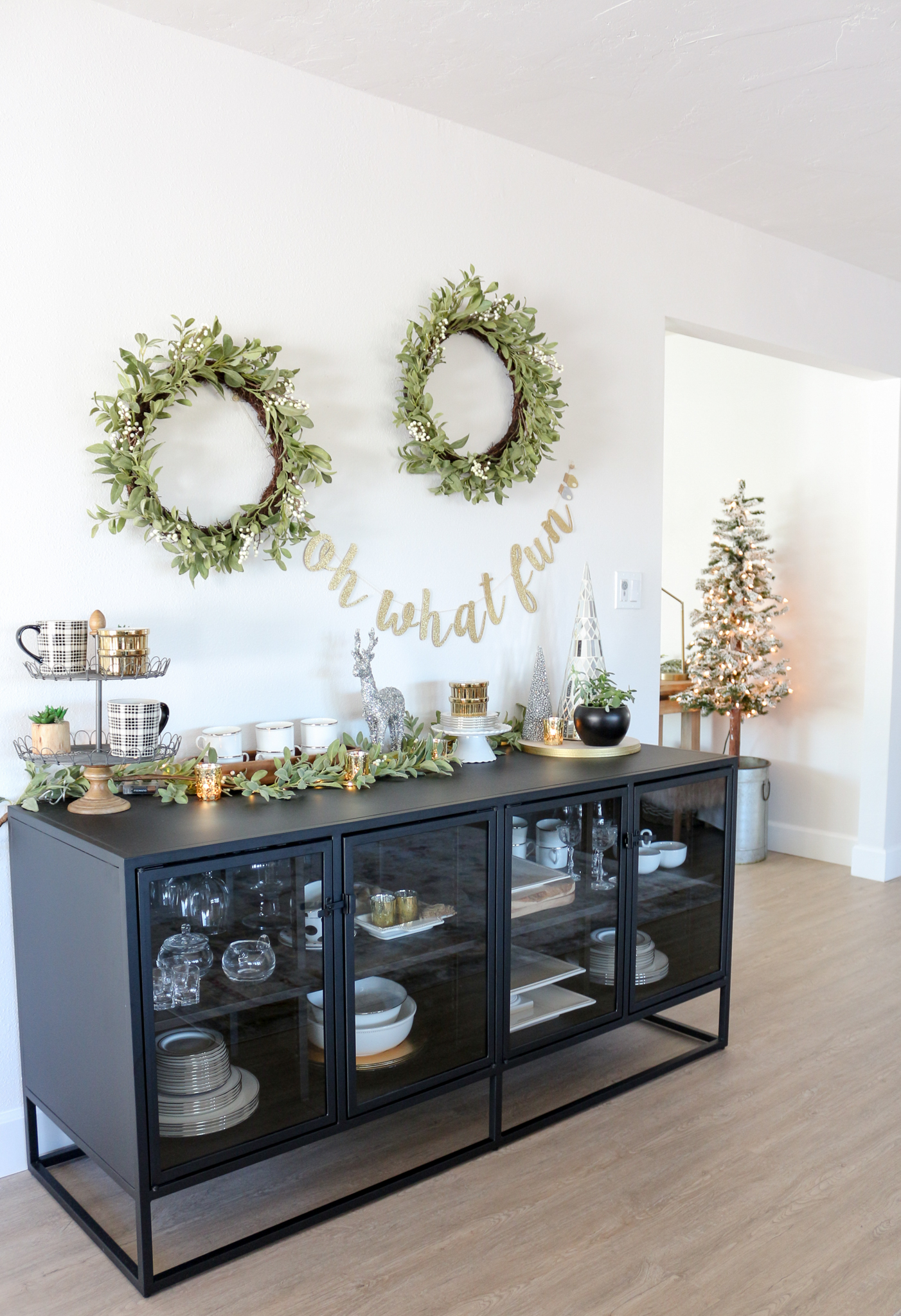 Black Sideboard Decorated Gold, White and Green for Christmas