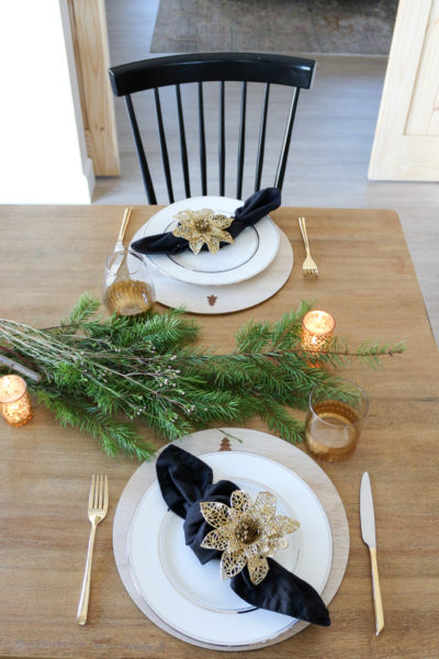 Rustic Elegant Black and Gold Christmas Tablescape