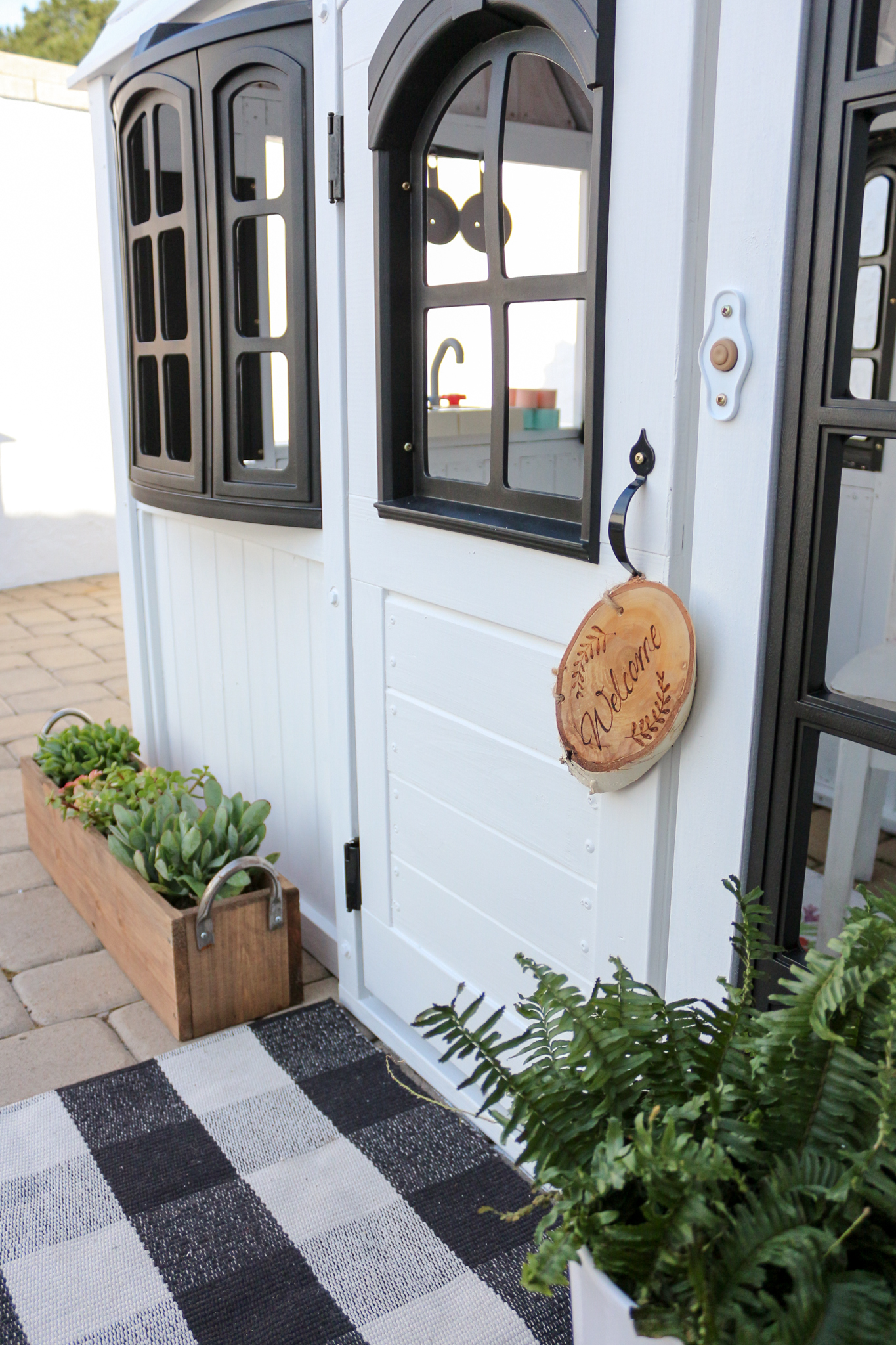 I Folded A Cute Buffalo Check Black And White Rug To Make It Fit In Front  Of The Playhouse Door And Added A Cute Wooden Welcome Sign To The Front Door .